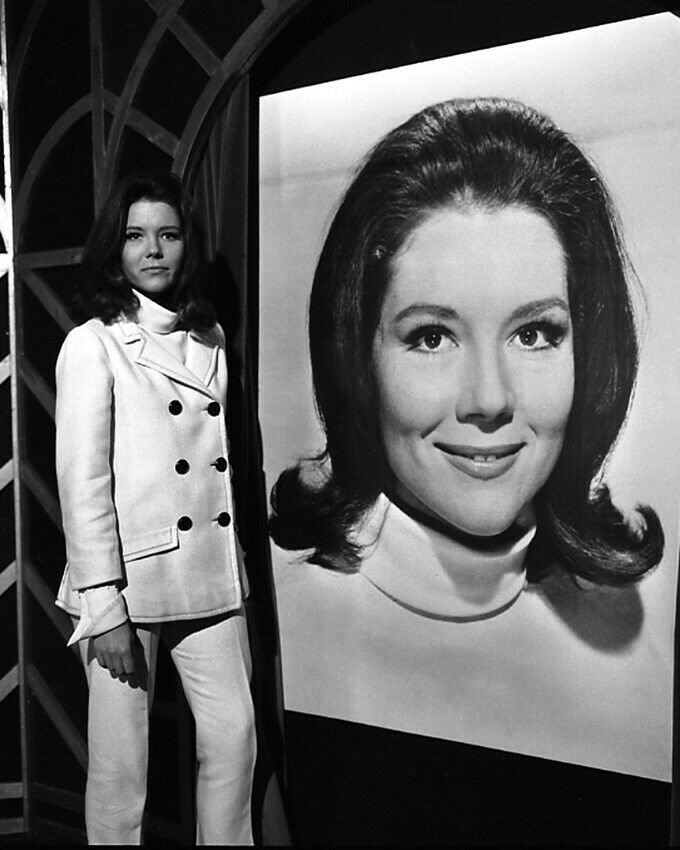 The Avengers Diana Rigg standing by large Emma Peel ima