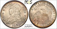 Undergraded 1829/7 Bust Half Dollar, O-101 1829 Over 7, O-101, PCGS Gold Shield Holder AU-55. This coin should be AU-58+, as there is just the faintest evidence of wear on otherwise flawless surfaces. At arm's length it looks full mint state, as you can see in the photo. The eye appeal is terrific. It has strong upgrade potential.