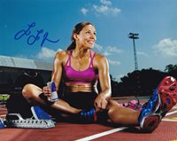 Lolo Jones In-person Autographed Photo Great color photo autographed by this American track and field and bobsled athlete who specializes in the 60 and 100 meter hurdles. She won three NCAA titles and garnered 11 All-American honors while at Louisiana State University. She won indoor national titles in 2007, 2008 and 2009 in the 60 m hurdles, with gold medals at the World Indoor Championship in 2008 and 2010.