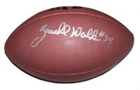 A Wilson NFL football signed by former running back Herschel Walker. Comes with a Certificate of Authenticity.