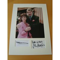 Signed pages by both mounted with a 10x8 photograph. John Challis & Sue Holderness 2.