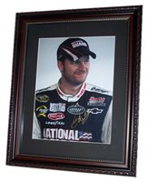 A 8.5 X 11 inch Dale Earnhardt Jr signed photograph matted in a 11 X 14 inch frame.