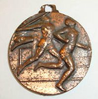Copper colored sports medal for 1963 high jump (3rd place)