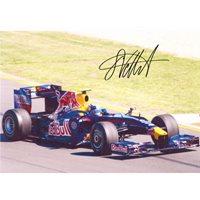 A signed 12x8 photograph by Sebastian Vettel. Sebastian Vettel 1.